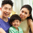 Chinese Family Sitting And Relaxing On Sofa Together At Home — Stock Photo