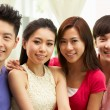 Group Of Young Chinese Friends Relaxing On Sofa At Home — Stock Photo
