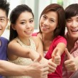 Group Of Young Chinese Friends Relaxing On Sofa At Home - Stock Photo