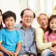 Stock Photo: Portrait Of Multi-Generation Chinese Family Relaxing At Home Tog