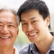 Portrait Of Chinese Father With Adult Son In Park — Stock Photo