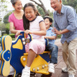 Stock Photo: Chinese Grandparents Playing With Grandchildren In Playground