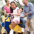 Chinese Grandparents Playing With Grandchildren In Playground — Stock Photo