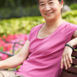 Senior Chinese Woman Relaxing On Park Bench — Stock Photo