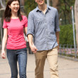 Foto Stock: Young Chinese Couple Walking In Park
