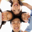 Young Chinese Family Looking Down Into Camera — Stock Photo #24445925