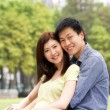 Young Chinese Couple Relaxing In Park Together — Stock Photo