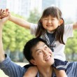 Chinese Father Giving Daughter Ride On Shoulders In Park — Stock Photo #24446351