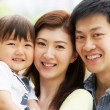 Portrait Of Chinese Family With Daughter In Park — Stock Photo