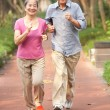 Stock Photo: Senior Chinese Couple Jogging In Park