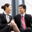 Chinese Businessman And Businesswoman Talking Outside Office — Stock Photo