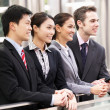 Stock Photo: Four Business Colleagues Outside Office