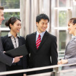 Four Business Colleagues Having Discussion Outside Office — Stock Photo
