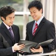Two Businessmen Discussing Document Outside Office — Stock Photo