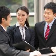 Three Business Colleagues Discussing Document Outside Office — Stock Photo #24447111