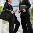 Two Chinese Businessmen Having Discussion Standing Outside Offic - Stock Photo