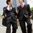 Two Chinese Businessmen Having Discussion Walking Down Steps Out — Stock Photo