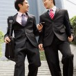 Stock Photo: Two Chinese Businessmen Having Discussion Walking Down Steps Out