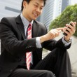 Chinese Businessman Dialling On Mobile Phone Outside Office — Photo