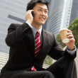Chinese Businessman Talking On Mobile Phone With Takeaway Coffee — Stock Photo