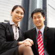 Portrait Of Chinese Businessman And Businesswoman Outside Office — Stock Photo #24447871
