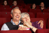 Senior Couple Watching Film In Cinema — Stock Photo