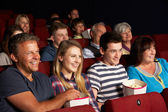 Teenage Family Watching Film In Cinema — Stock Photo