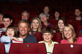Family Watching Film In Cinema — 图库照片