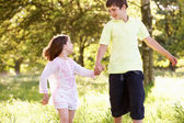 Boy And Girl Running Through Summer Field Together — Stock Photo
