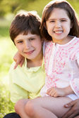 Two Children Giving One Another Hug In Summer Field — Stock Photo