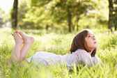 Young Girl Daydreaming Lying In Summer Field — Stock Photo