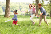 Parents Playing Exciting Adventure Game With Children In Summer — Stock Photo