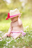 Baby Girl In Summer Dress Sitting In Field Wearing Straw Hat — Stock Photo