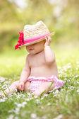Baby Girl In Summer Dress Sitting In Field Wearing Straw Hat — Stock Photo