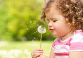 Young Girl In Summer Dress Sitting In Field Blowing Dandelion — Stock Photo