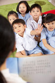 Teacher Reading To Students In Chinese School Classroom — Stok fotoğraf