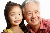 Studio Shot Of Chinese Grandfather With Granddaughter — Stock Photo
