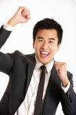 Studio portret van chinese zakenman vieren — Stockfoto