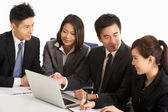 Studio Shot Of Chinese Businesspeople Having Meeting — Stock Photo