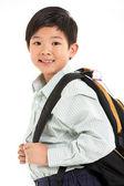 Foto estudio de muchacho chino en uniforme escolar — Foto de Stock