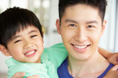 Head And Shoulders Portrait Of Chinese Father And Son — Stock Photo