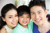 Head And Shoulders Portrait Of Chinese Family Together At Home — Stock Photo