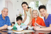 Portrait Of Multi-Generation Chinese Family Eating Meal Together — Stock Photo