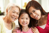Female Multi Genenration Chinese Family Group Relaxing At HomeTo — Stock Photo
