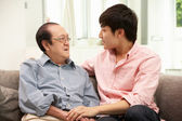 Portrait Of Chinese Father With Adult Son Relaxing At Home — Stock Photo