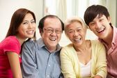 Portrait Of Chinese Parents With Adult Children Relaxing At Home — Stock Photo