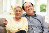 Senior Chinese Couple Relaxing On Sofa At Home — Stock Photo