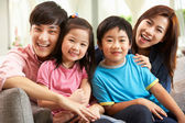 Chinese Family Relaxing On Sofa At Home — Stock Photo