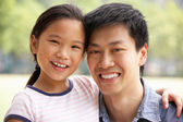Portrait Of Chinese Father With Daughter In Park — Stock Photo