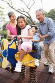 Chinese Grandparents Playing With Grandchildren In Playground — Stock Photo